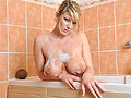 British babe Lexy soaping up her juggs and pussy in the bath