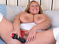 Carol Brown plays with her giant boobs and toy fucking pussy