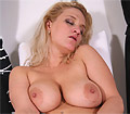 Jana plays with her massive boobs and dildo fucks her beaver