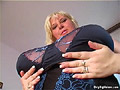 June Kelly fondels her big melons and finger fucks her pussy