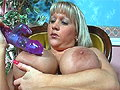 Cherry B shows off her melon tits before fucking a big dildo