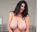 Huge melons Lulu Lush getting naked and horny in the bedroom