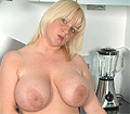 Cherry B plays with her hooters and fucking with a big dildo