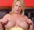 Libby showing off her melons and fingering her shaved beaver