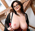 Theres shows her huge boobs and dildo fucking her plump cunt